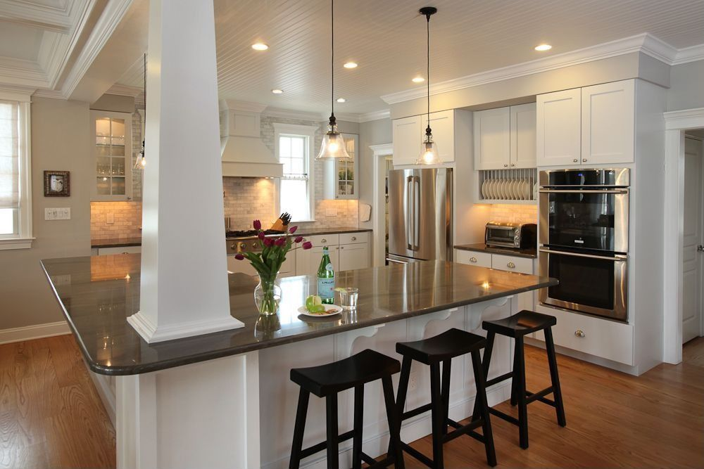 Traditional Kitchen with Standard height, Crown molding, Shades of light clear glass dome industrial pendant, can lights