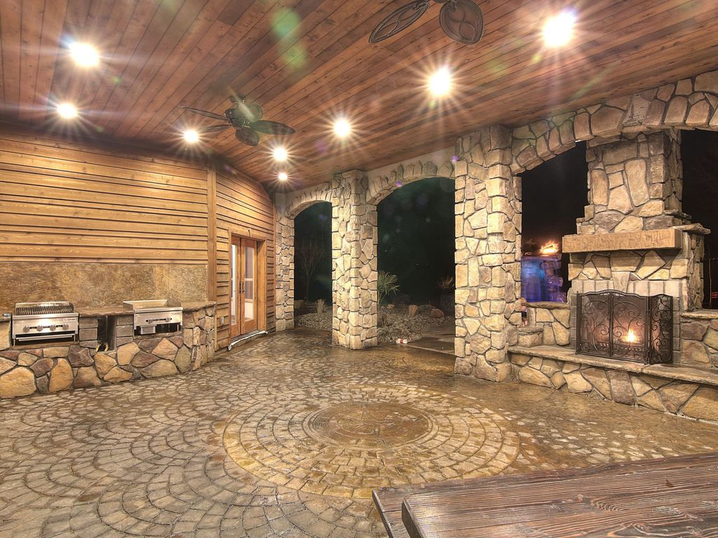 Rustic Patio with French doors, Built-in bench seating, Built in outdoor grill, Horizontal wood paneling, Outdoor kitchen