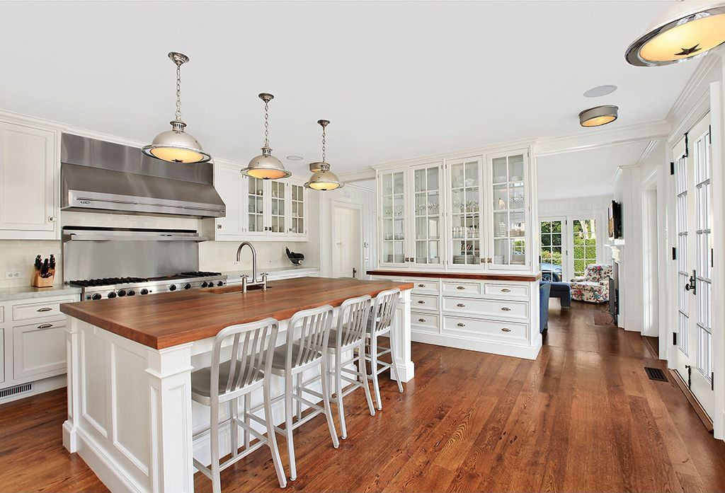Traditional Kitchen with Wood counters, Emeco navy barstool, French doors, full backsplash, Breakfast bar, Undermount sink