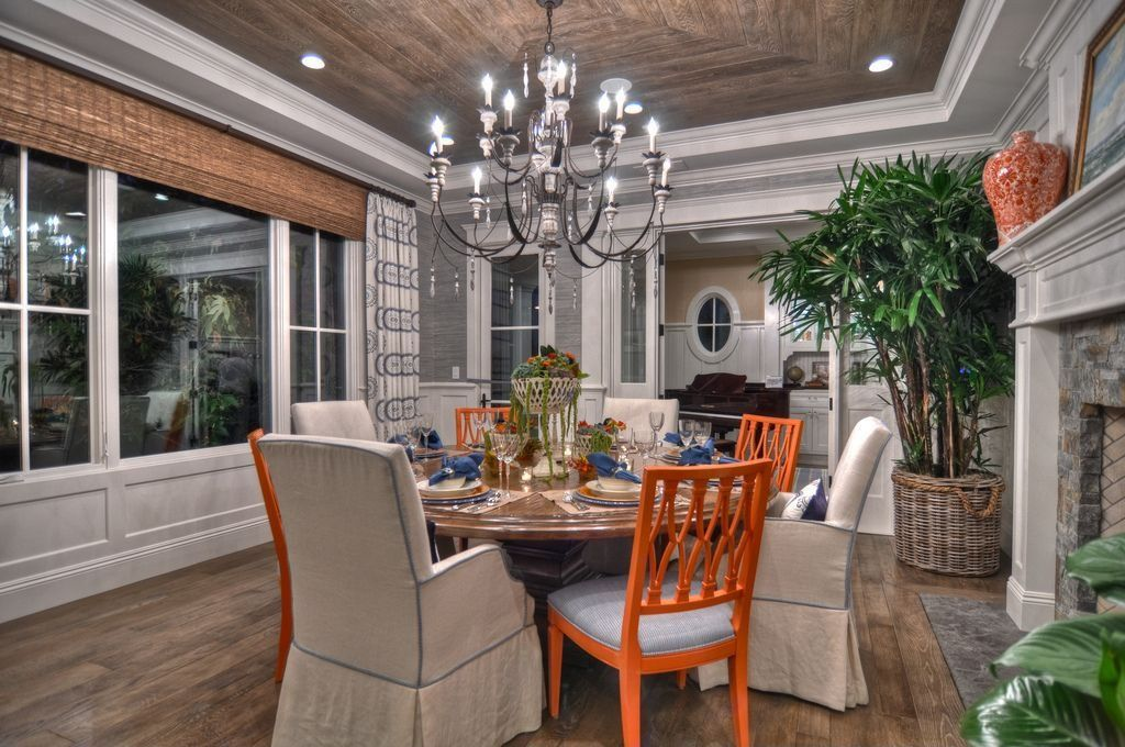 Contemporary Dining Room with Casement, picture window, Standard height, brick fireplace, Hardwood floors, can lights
