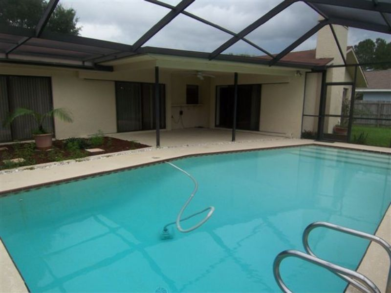 Traditional Swimming Pool with exterior tile floors, Fence, Skylight, Indoor pool