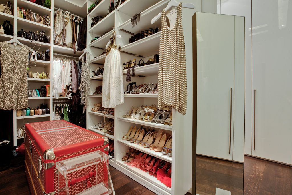 Contemporary Closet with Laminate floors, Goyard Trunk, Paint 1, High ceiling, Design Within Reach Mondrian Mirror