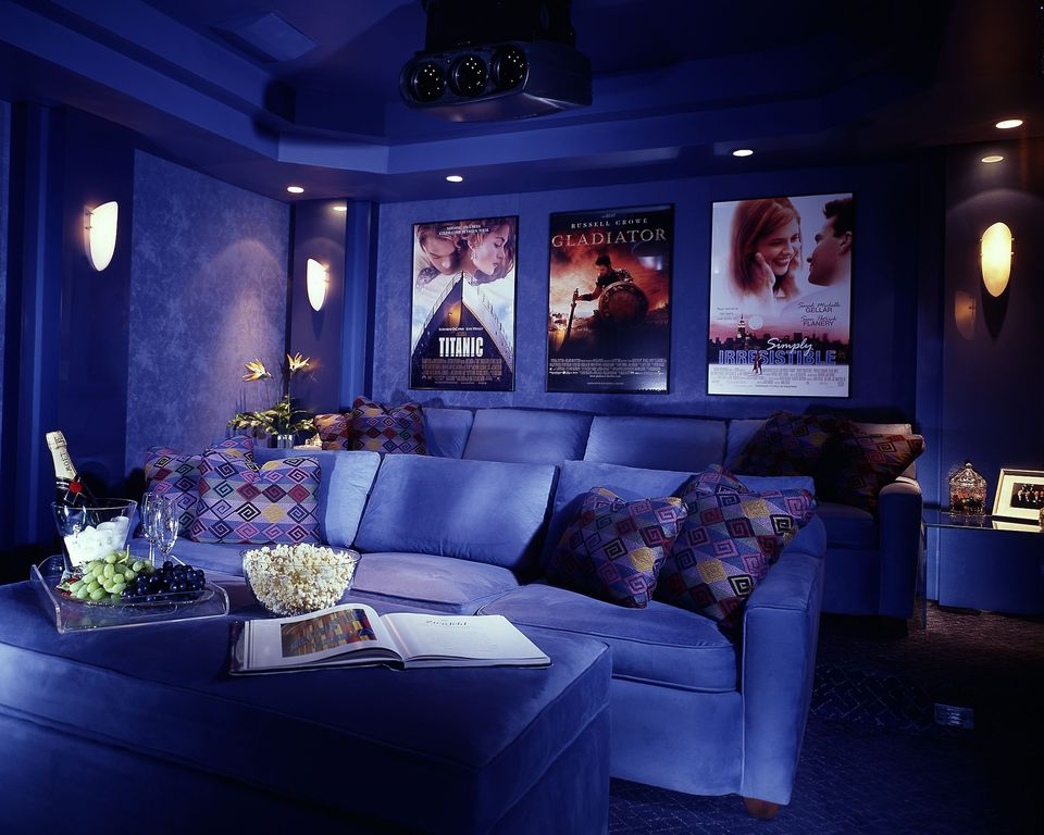 Traditional Home Theater with Trey ceiling, Wall sconce, Carpet, Projector, can lights, High ceiling, interior wallpaper