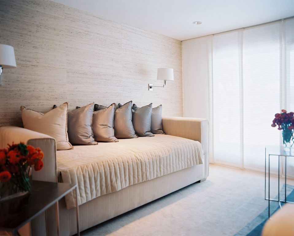 Contemporary Guest Bedroom with specialty door, Carpet, can lights, Standard height, Wall sconce