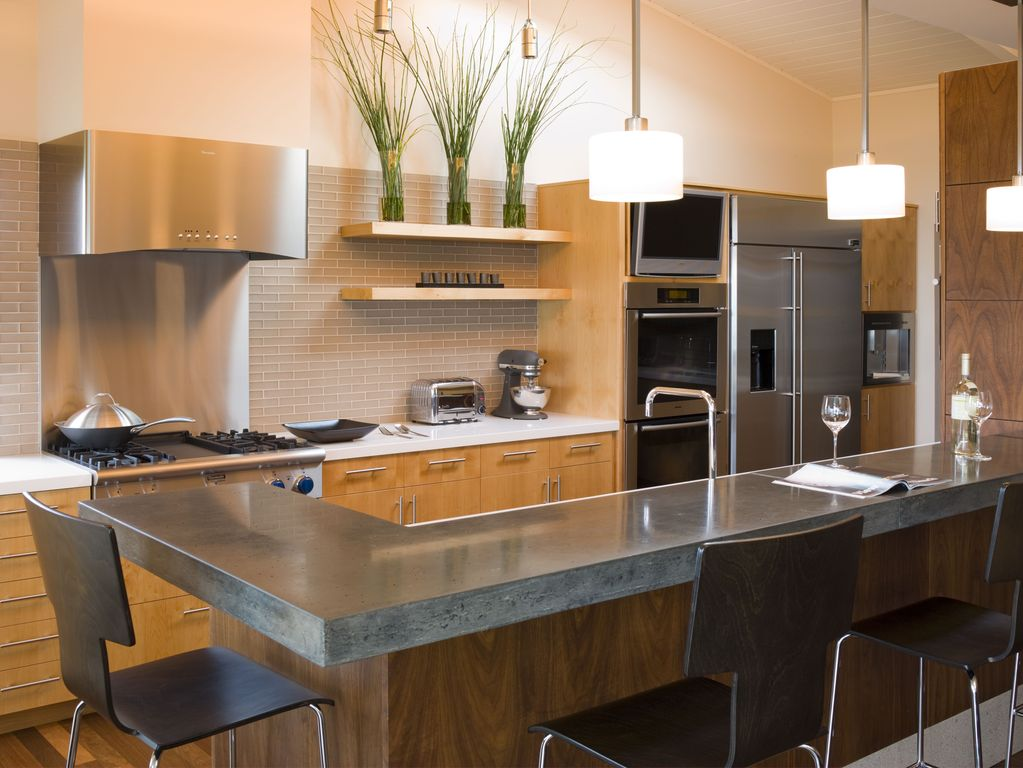 Contemporary Kitchen with Polished stainless-steel backsplash, Concrete counters, High ceiling, Flush, Paint, Wall Hood