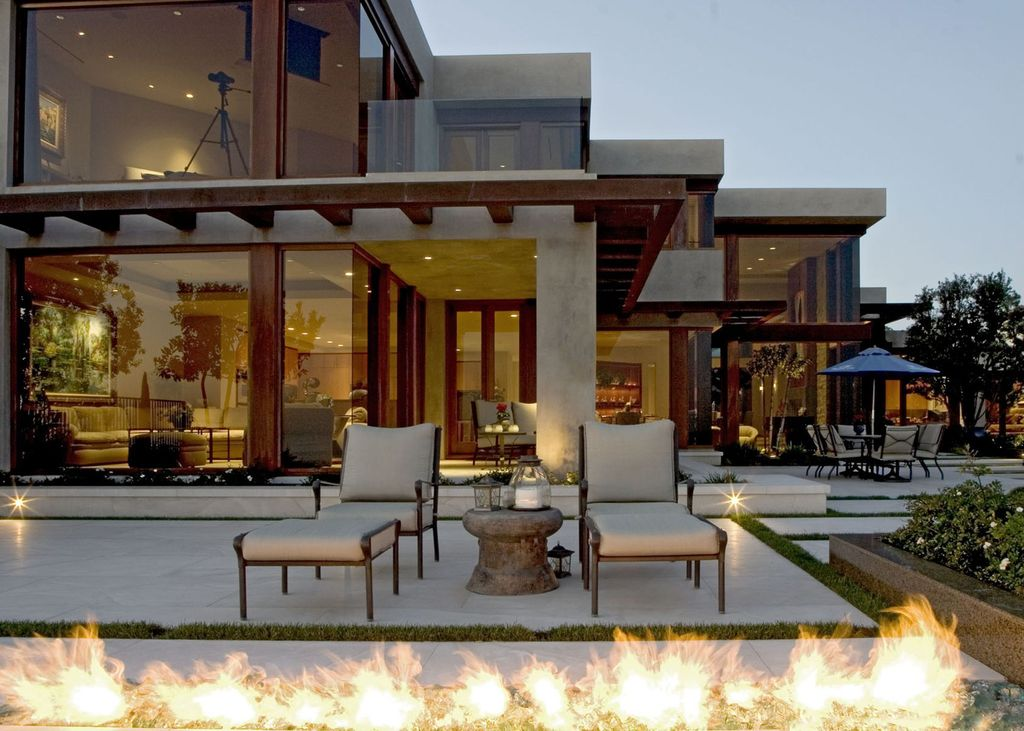 Contemporary Patio with picture window, Fire pit, Natural light, French doors, Outdoor seating area, Glass door, Raised beds