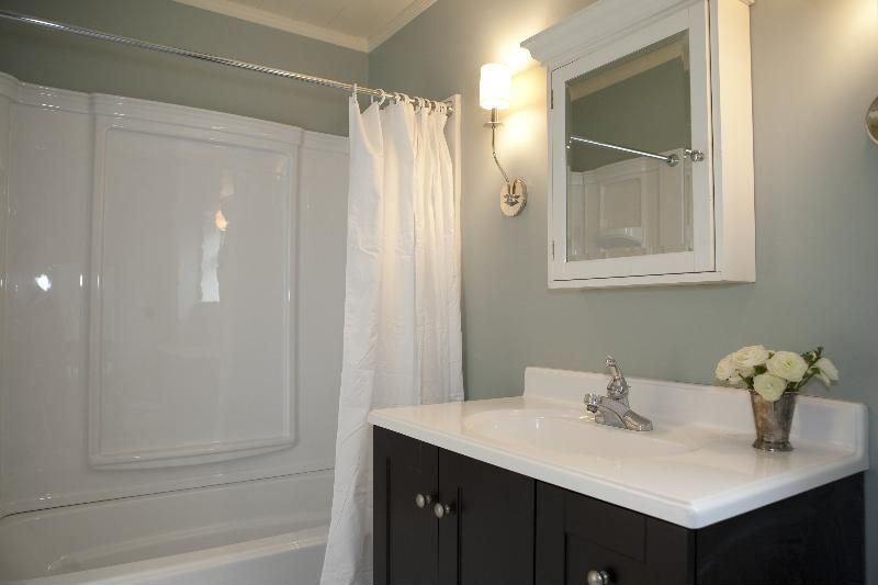 Contemporary Full Bathroom with Simple marble counters, partial backsplash, Crown molding, Simple Marble, Standard height