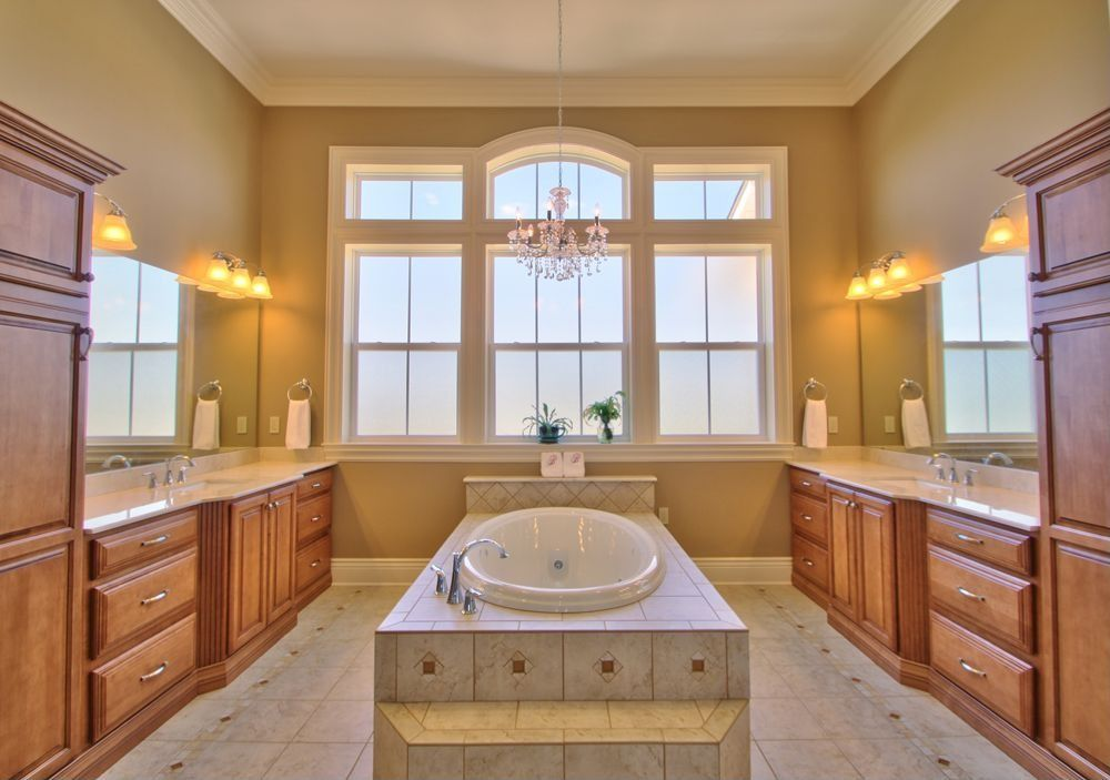 Traditional Master Bathroom with Master bathroom, Inset cabinets, Crown molding, Undermount sink, Bathtub, picture window