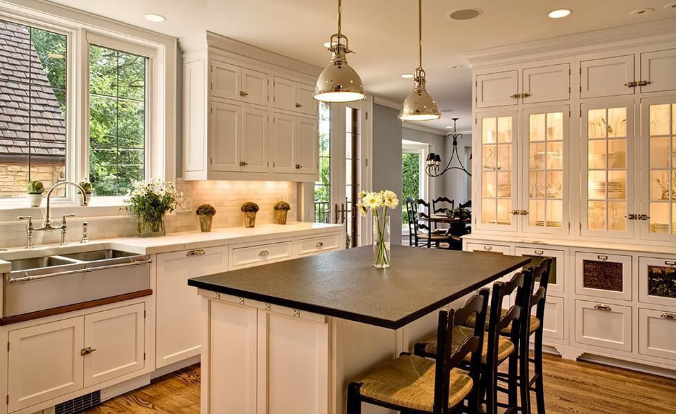 Traditional Kitchen with Subway Tile, Paint, apron sink, Crown molding, Shaker style cabinets, Dupont corian deep nocturne