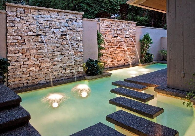 Contemporary Swimming Pool with Fence, Fountain, exterior concrete tile floors, Exposed stone wall, Other Pool Type, Pathway
