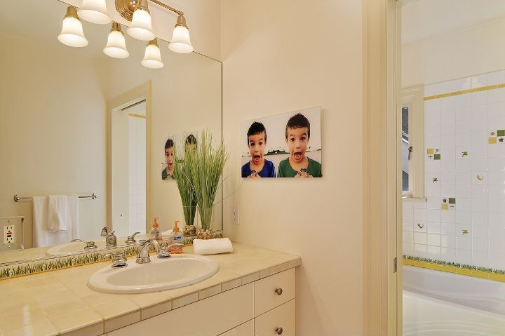 Modern Kids Bathroom with Paint, Glass panel, large ceramic tile counters, Flat panel cabinets, Kids bathroom, drop-in sink