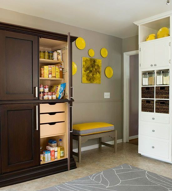 Contemporary Pantry with Crown molding, Built-in bookshelf, Standard height, complex marble tile floors, Chair rail