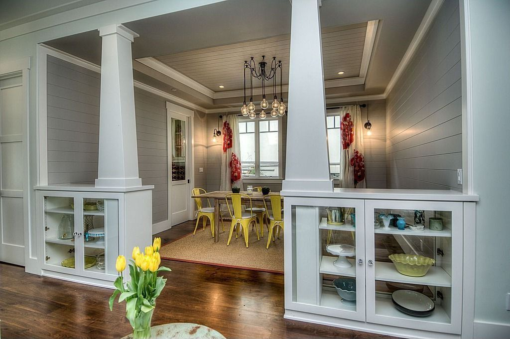 Contemporary Dining Room with Casement, Crown molding, Built-in bookshelf, Glass panel door, Columns, Paint, Hardwood floors