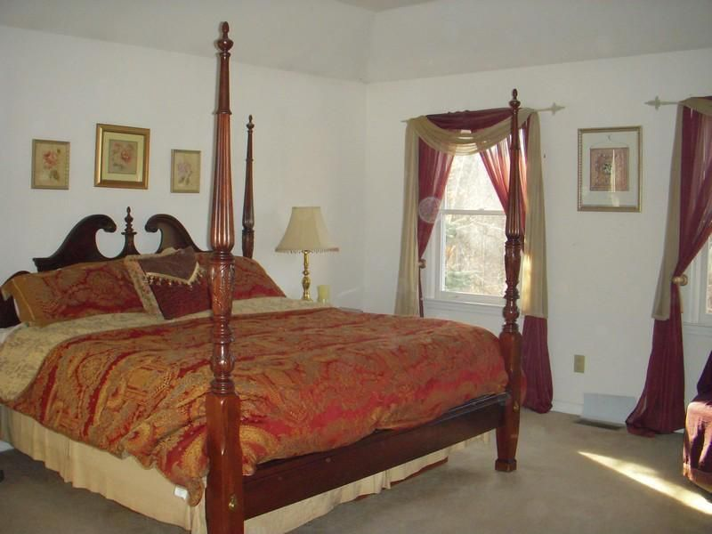 Traditional Master Bedroom with Carpet, Standard height, double-hung window