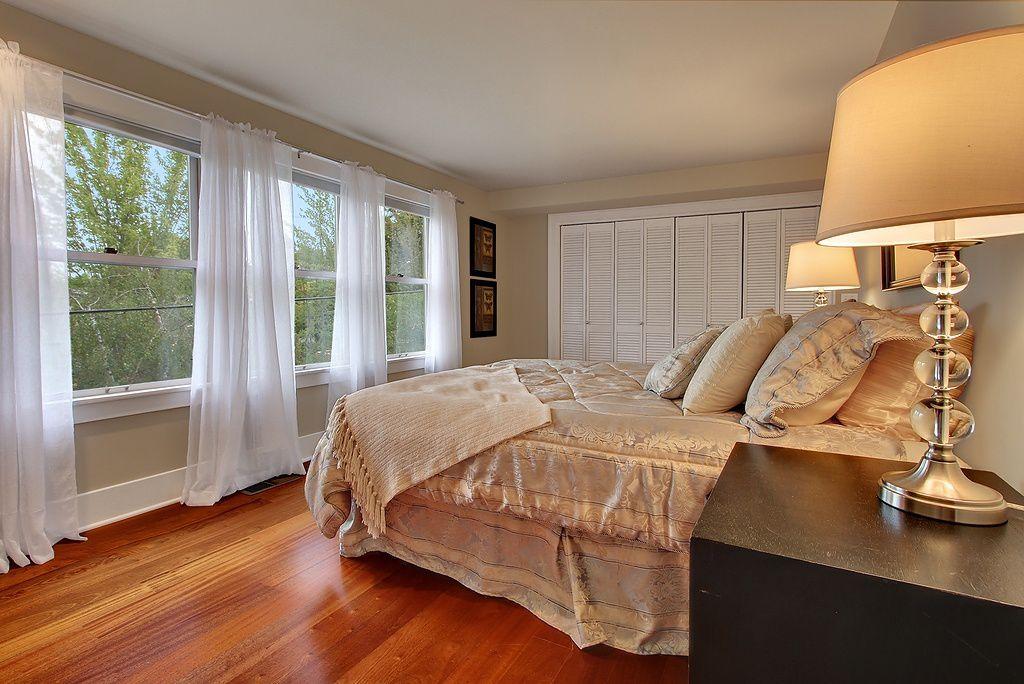Modern Guest Bedroom with Standard height, double-hung window, Hardwood floors