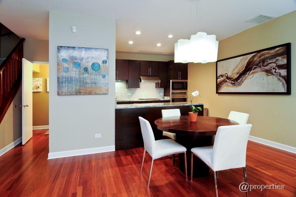 Modern Great Room with Chandelier, Hardwood floors, Built-in bookshelf