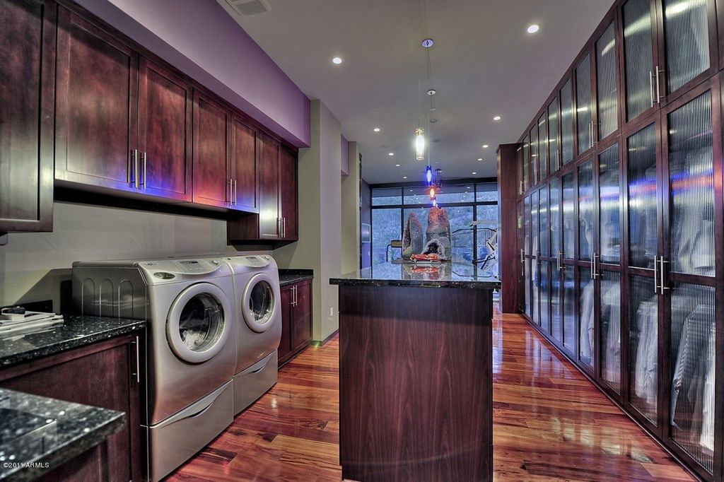 Contemporary Laundry Room with picture window, Built-in bookshelf, can lights, Pendant light, Paint 2, Laminate floors