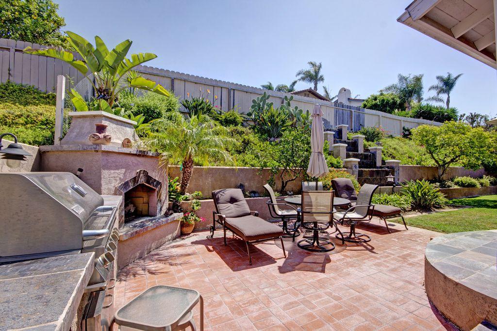 Mediterranean Patio with outdoor pizza oven, Outdoor kitchen, exterior brick floors, Fence, exterior stone floors