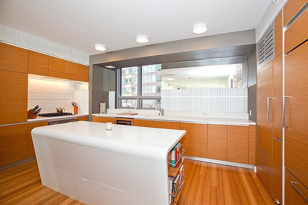 Contemporary Kitchen with Multiple Refrigerators, Built-in bookshelf, Undermount sink, Flush, European Cabinets, wall oven