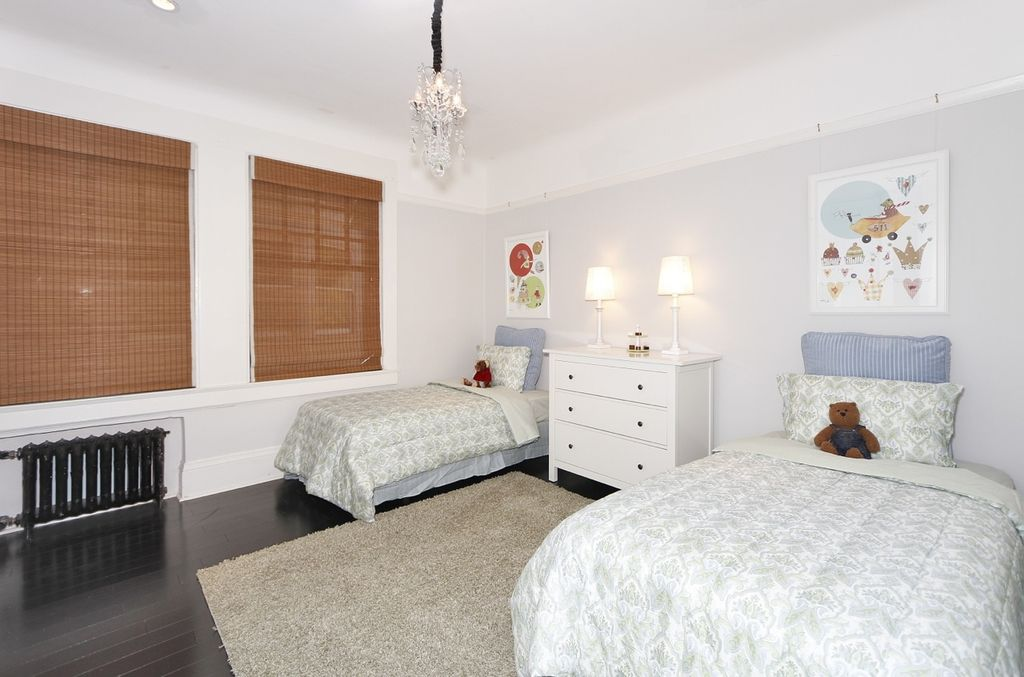 Traditional Guest Bedroom with Chandelier, Hardwood floors, no bedroom feature, double-hung window, can lights