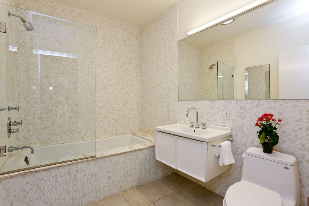 Contemporary 3/4 Bathroom with Undermount bathroom sink, terracotta tile floors, tiled wall showerbath, shower bath combo