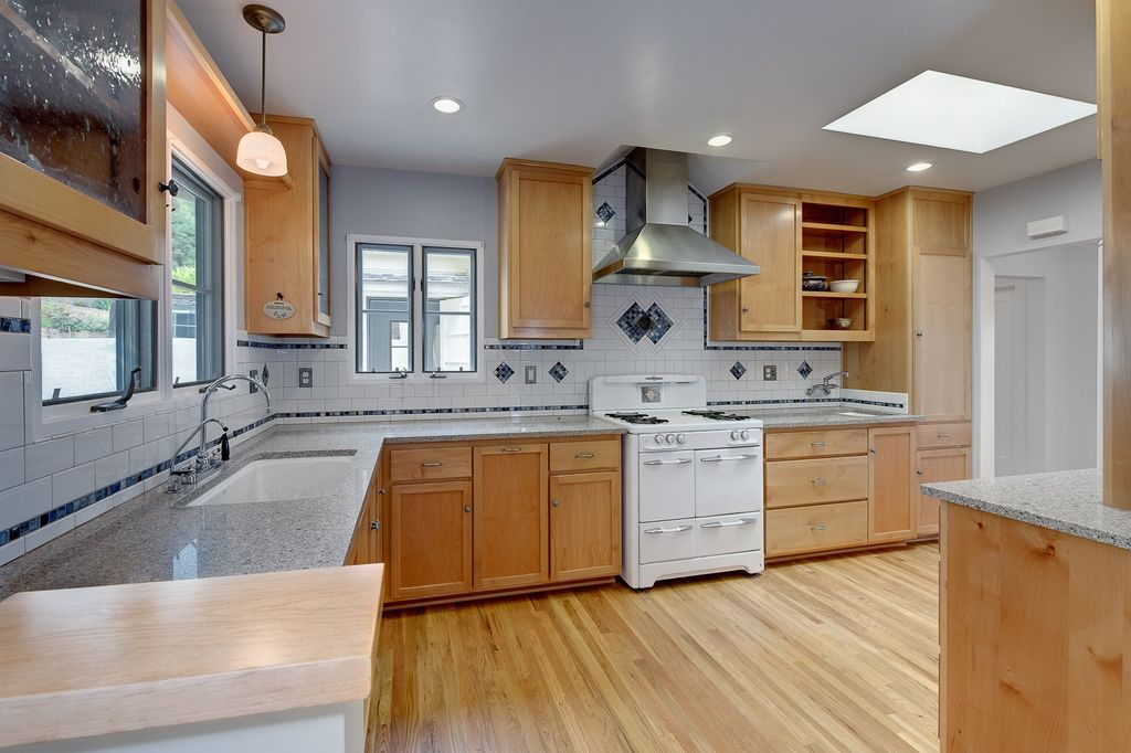 Eclectic Kitchen with Glass panel, double oven range, can lights, Wall Hood, Standard height, Flush, Hardwood floors