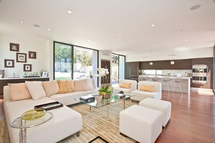 Contemporary Great Room with Standard height, Built-in bookshelf, can lights, specialty window, Carpet, Laminate floors