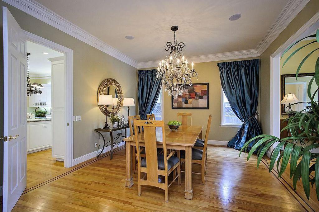 Traditional Dining Room with Chandelier, Hardwood floors, six panel door, Casement, Crown molding, Standard height