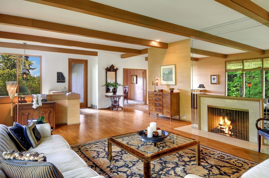 Craftsman Living Room with Standard height, Laminate floors, specialty window, Fireplace, Carpet, stone fireplace, can lights