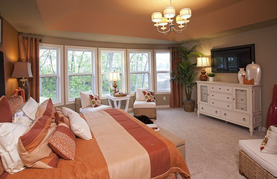 traditional master bedroom with carpet high ceiling