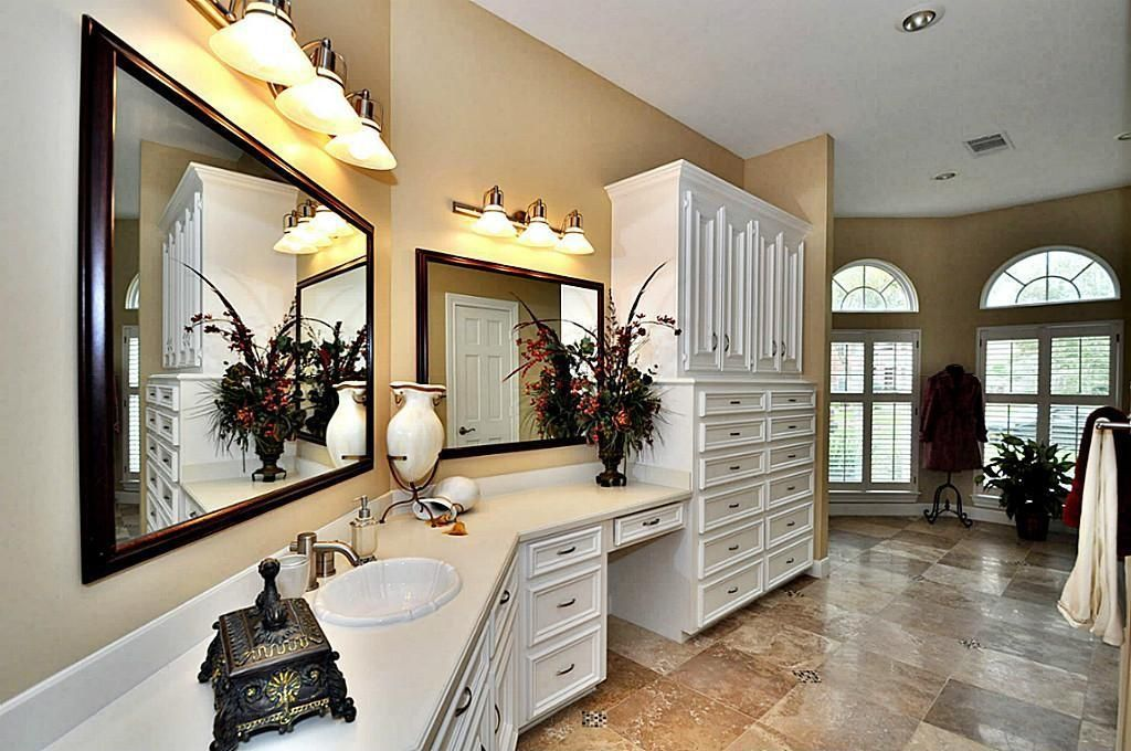 Traditional Full Bathroom with Arched window, Flat panel cabinets, Built-in bookshelf, Powder room, Onyx, Onyx counters
