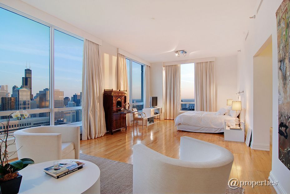 Contemporary Master Bedroom with flush light, Standard height, Hardwood floors, picture window