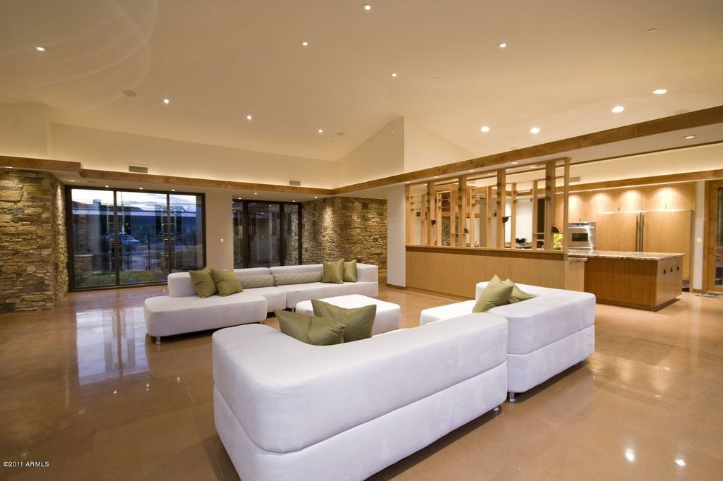 Contemporary Living Room with Concrete floors, sliding glass door, Standard height, can lights