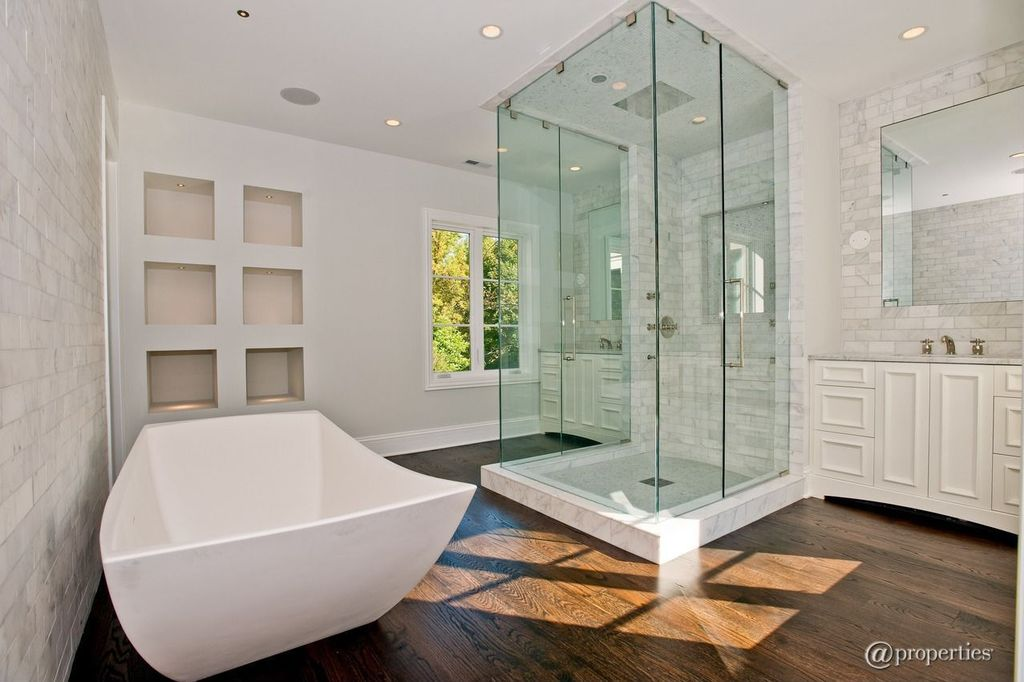 Contemporary Master Bathroom with Freestanding, Frameless, Flat panel cabinets, Paint, Bathtub, Complex marble counters