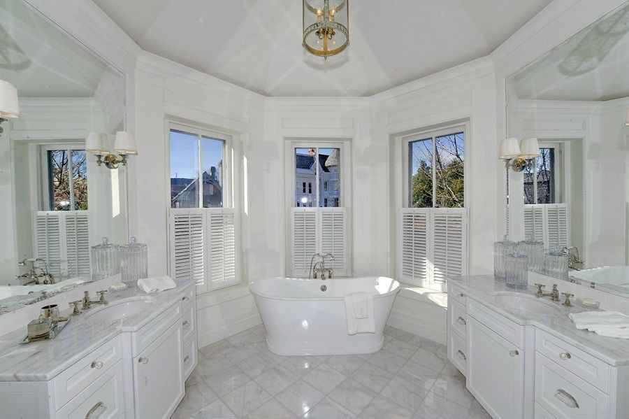 Traditional Master Bathroom with Hudson Valley Rockville Polished Nickel One-Light Wall Sconce, Framed Partial Panel, Bathtub