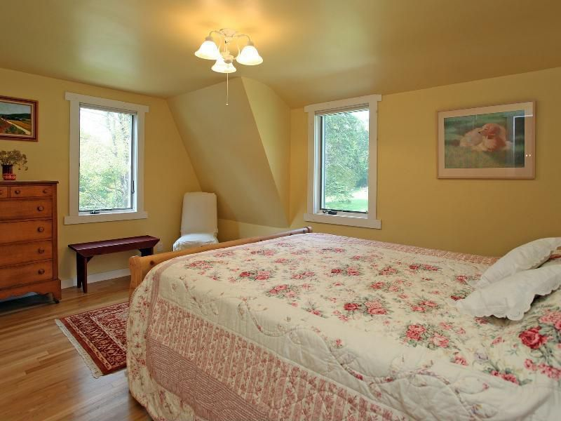 Country Guest Bedroom with flush light, Hardwood floors, Casement, picture window, Box ceiling, Laminate floors