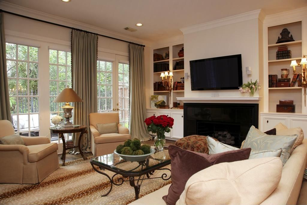 Traditional Living Room with Hardwood floors, Built-in bookshelf, Wall sconce, French doors, Carpet, can lights, Fireplace