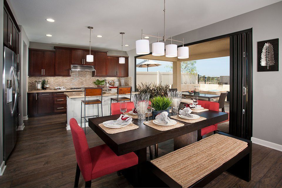 Modern Kitchen with Laminate floors, Built In Refrigerator, Kitchen island, Flat panel cabinets, Framed Partial Panel