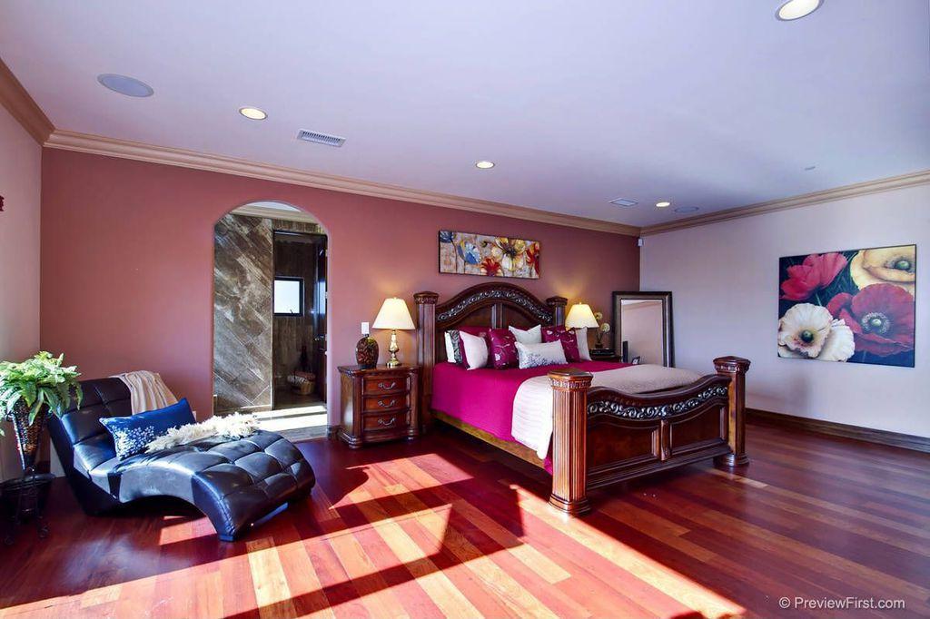 Eclectic Master Bedroom with Crown molding, can lights, Standard height, Hardwood floors, specialty door