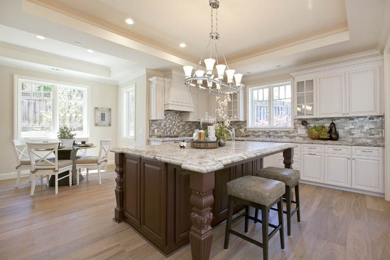 Traditional Kitchen with can lights, Framed Partial Panel, Chandelier, Casement, Simple granite counters, Breakfast bar