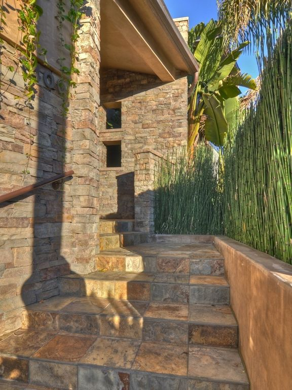 Contemporary Staircase with Stone stair, Exterior stucco walls