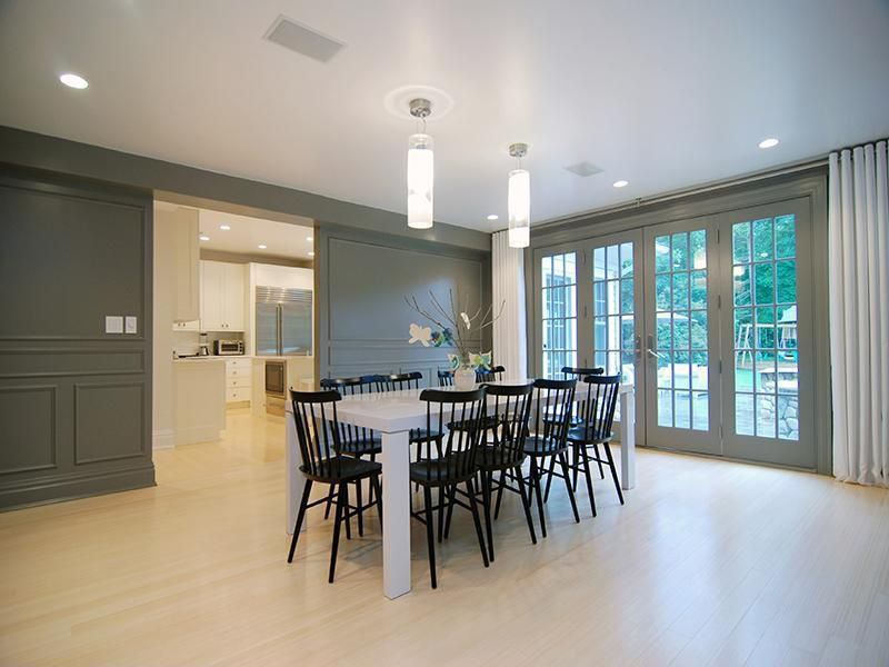 Contemporary Dining Room with Pendant light, French doors, Laminate floors, Ceiling fan