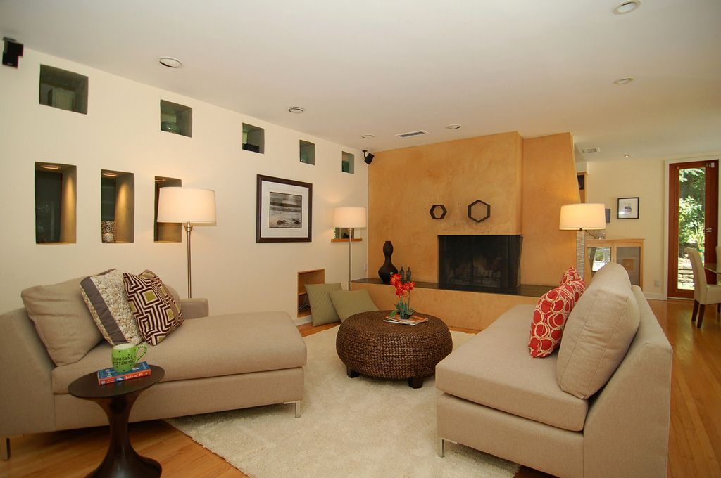 Modern Living Room with Carpet, other fireplace, Standard height, Fireplace, French doors, Laminate floors, can lights