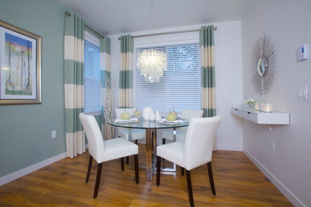 Contemporary Dining Room with specialty window, Chandelier, picture window, Hardwood floors, Standard height