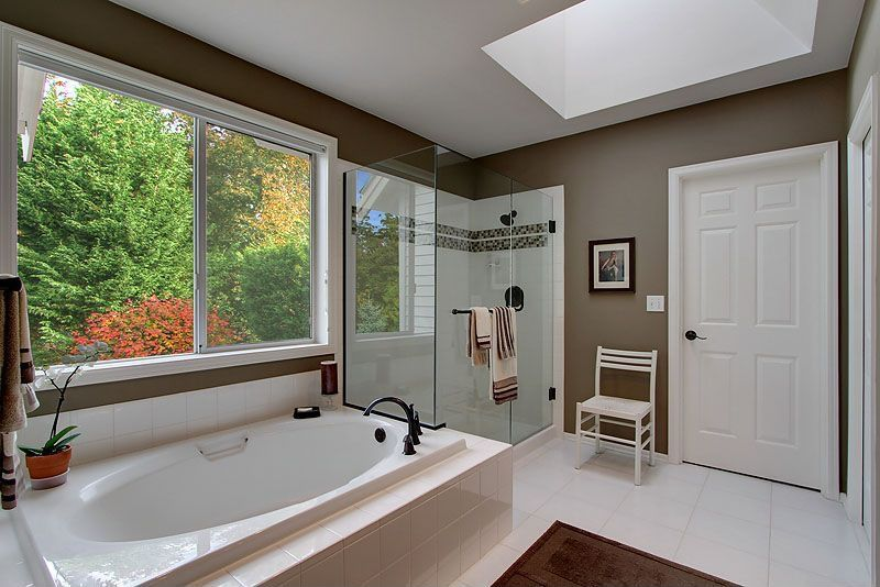 Traditional Master Bathroom with Master bathroom, drop in bathtub, Shower, stone tile floors, Bathtub, Standard height