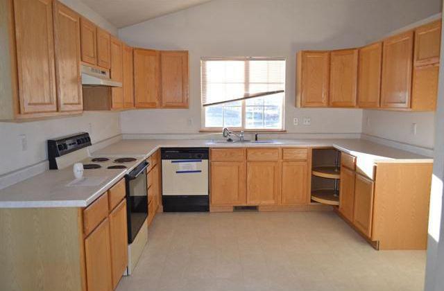 Craftsman Kitchen with limestone tile floors, stone tile floors, Inset cabinets, U-shaped, Raised panel, High ceiling