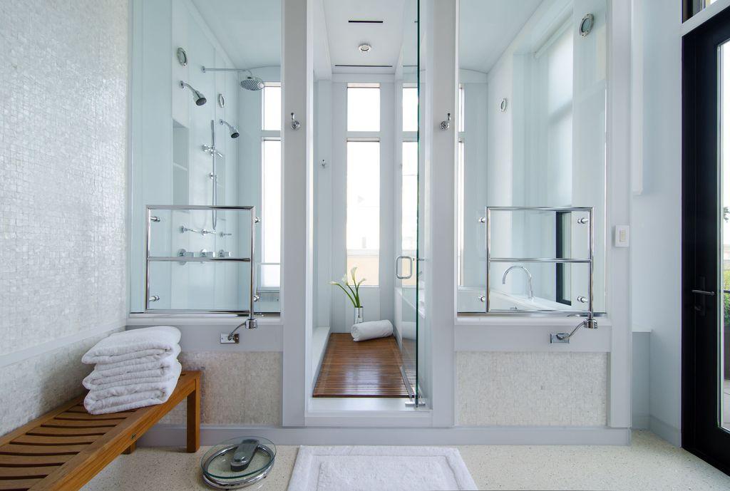 "Contemporary Master Bathroom with Teak floor, Paint 1, Teak backless bench rosemont - 48"", 33"" nashua hardwired towel warmer"
