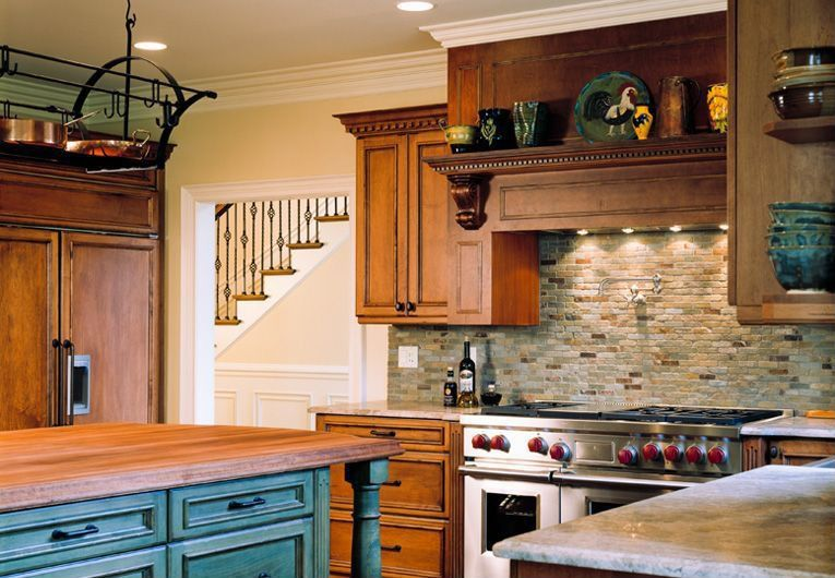 Traditional Kitchen with Flat panel cabinets, full backsplash, Stone Tile, Custom hood, Limestone Tile, Standard height