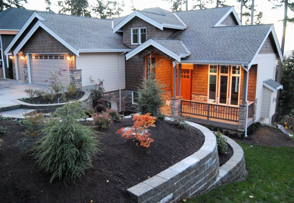 Craftsman Landscape/Yard with exterior stone floors, Raised beds, picture window, Glass panel door, Deck Railing