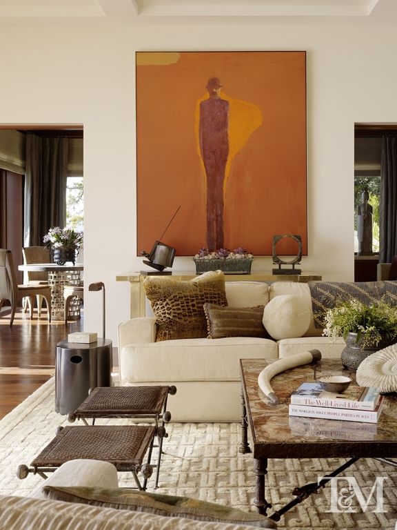 Contemporary Living Room with Crown molding, Artwork, Neutral area rug, High ceiling, Coffered ceiling, End table, Ottoman